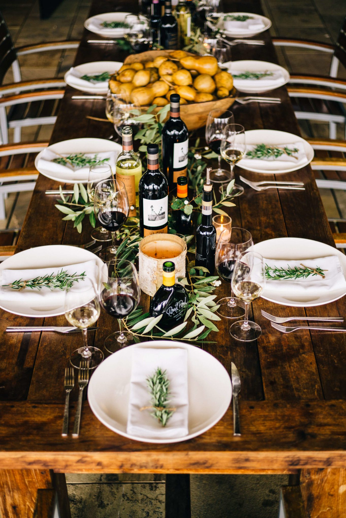 Thanksgiving table set with a big bowl of gourds at round pond estate winery in napa with the taste sf