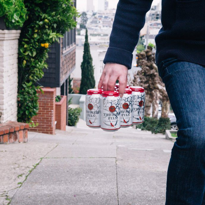 The Taste SF carrying Trumer Pils Cans in San Francisco