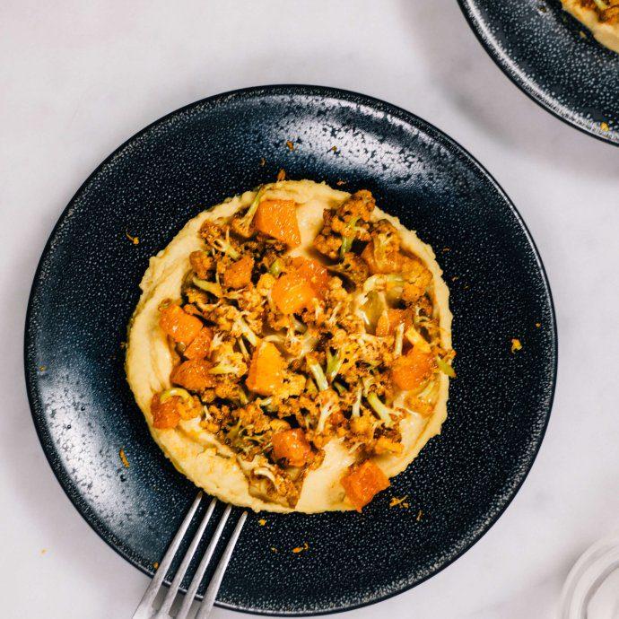 Roasted Harissa Cauliflower on a bed of homemade hummus recipe