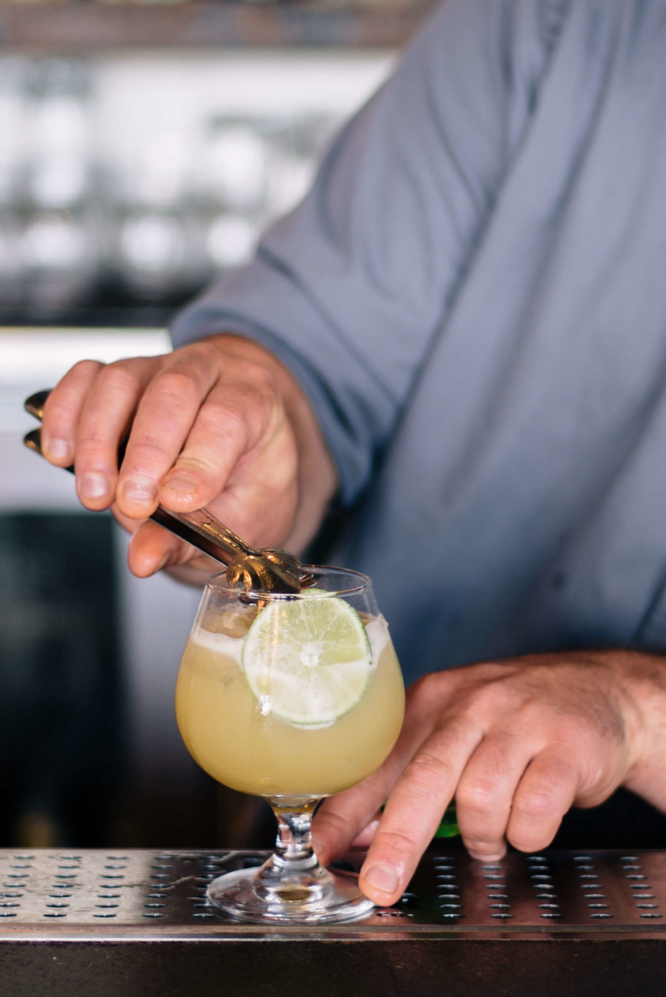 Placing lime garnishes San Francisco Summer Cocktails: Hog Island Saul Ranella Sacred Cenote Mezcal Amaro Cocktail Recipe, restaurant recipe, The Taste SF