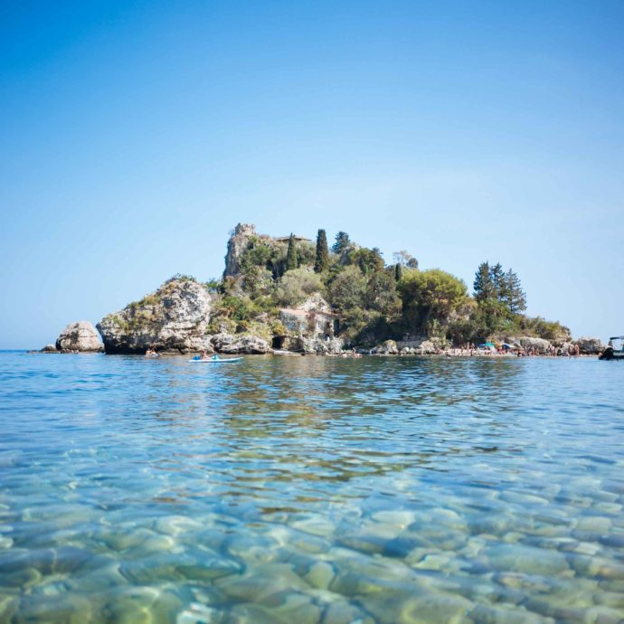 Dip in the water and sip a cocktail at Isola Bella in Sicily like The Taste SF