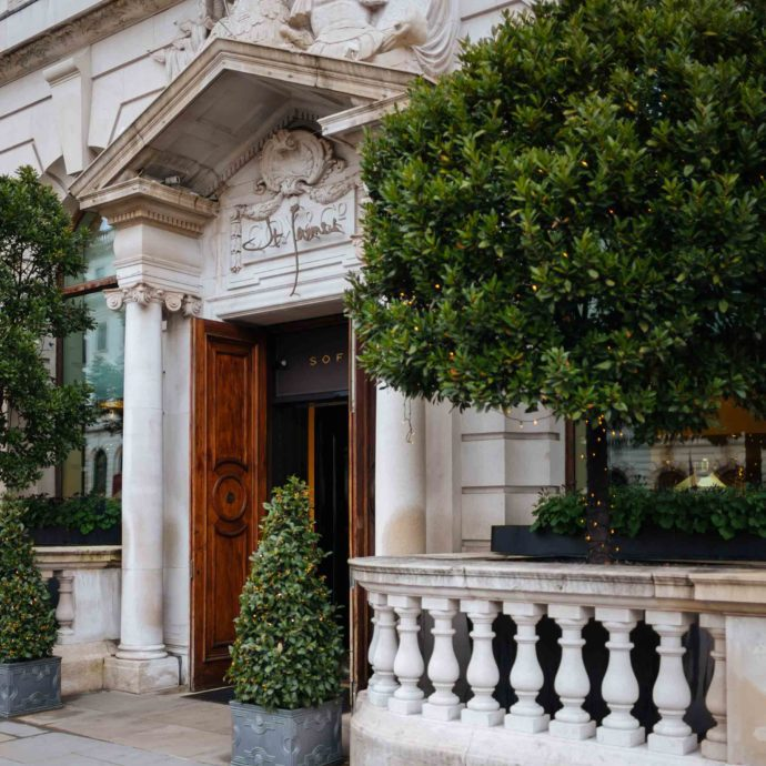 The Taste SF culinary travel bloggers and photographers recommends when in London, stay at the Sofitel London St. James, one of the best luxury hotels in London with it's spectacular entrance and greenery framing the door #travel #london #hotel