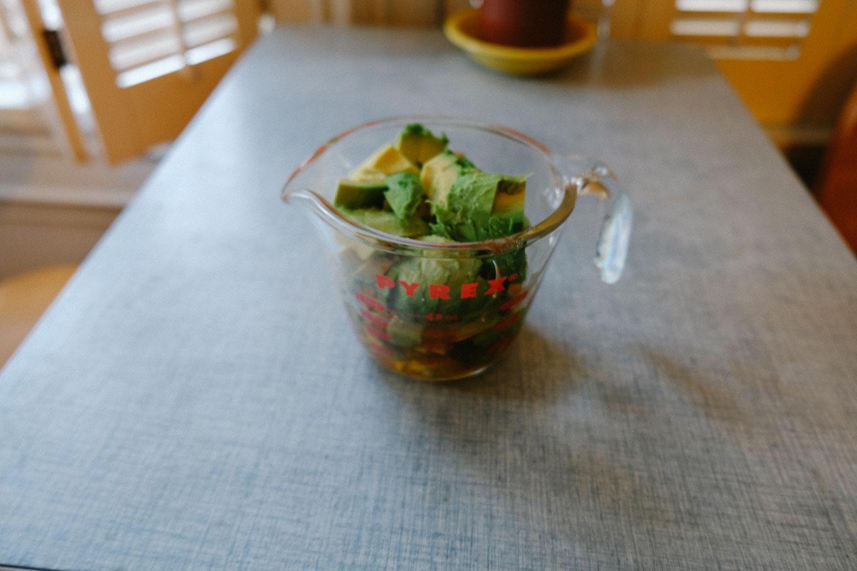 garlic and honey-marinated avocado, mango, roasted chicken salad