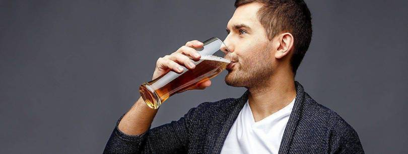 Man drinking Belgian Beer