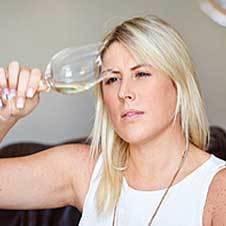 A woman testing wine