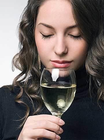 A woman tasting wine