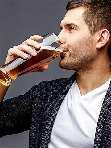 A man tasting beer