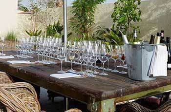 A table with wine glasses lined up