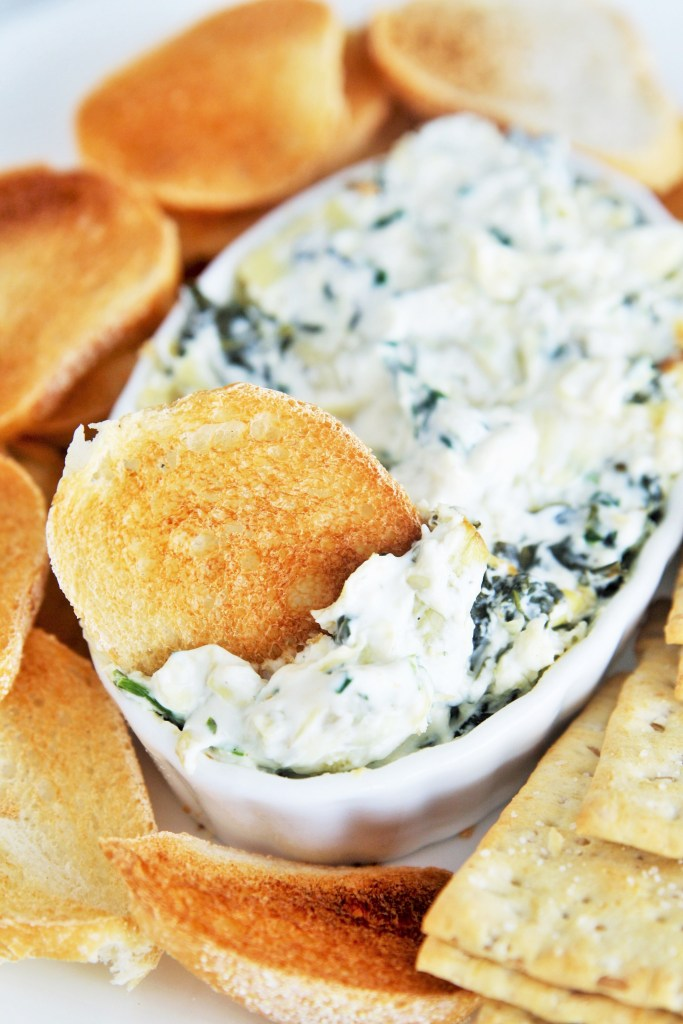 Hot spinach and artichoke dip with creamy texture and cheesy, garlicky taste - this will become your go-to party appetizer!