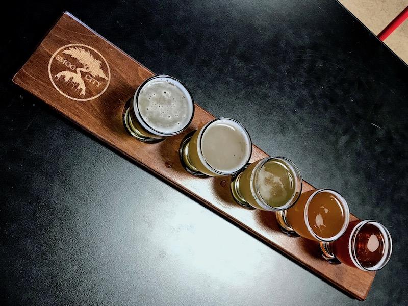 beer flight at smog city