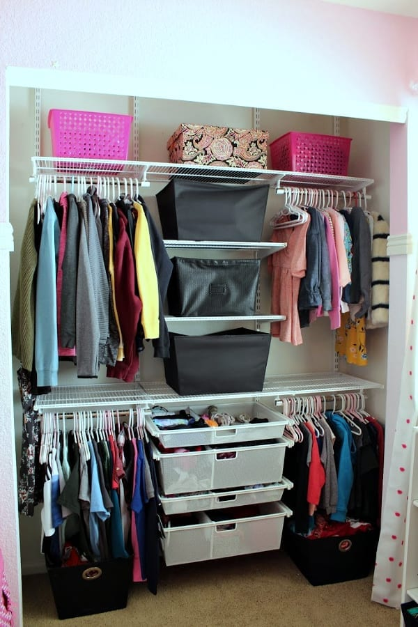 a shared kids closet perfectly organized
