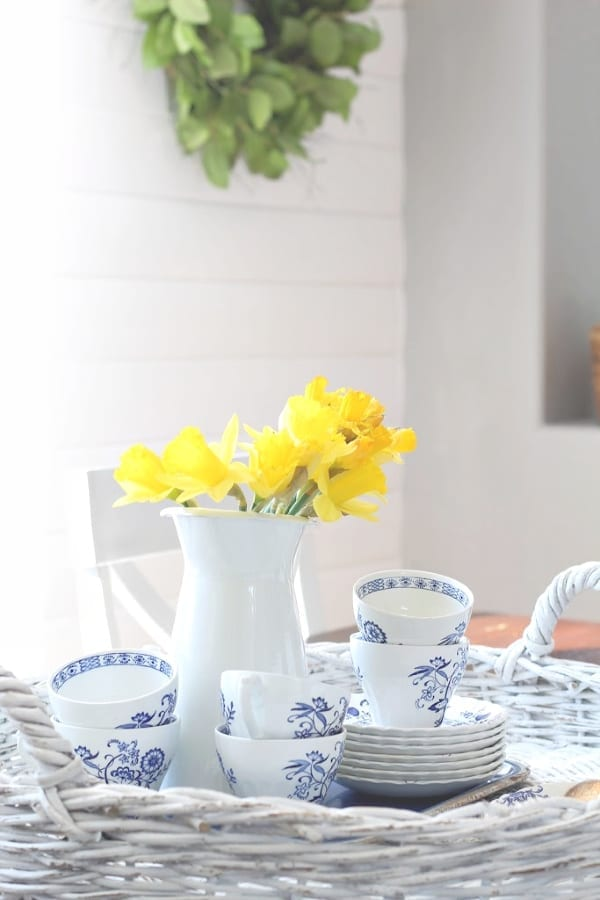 a pretty vignette of daffodils and blue and white ironstone.
