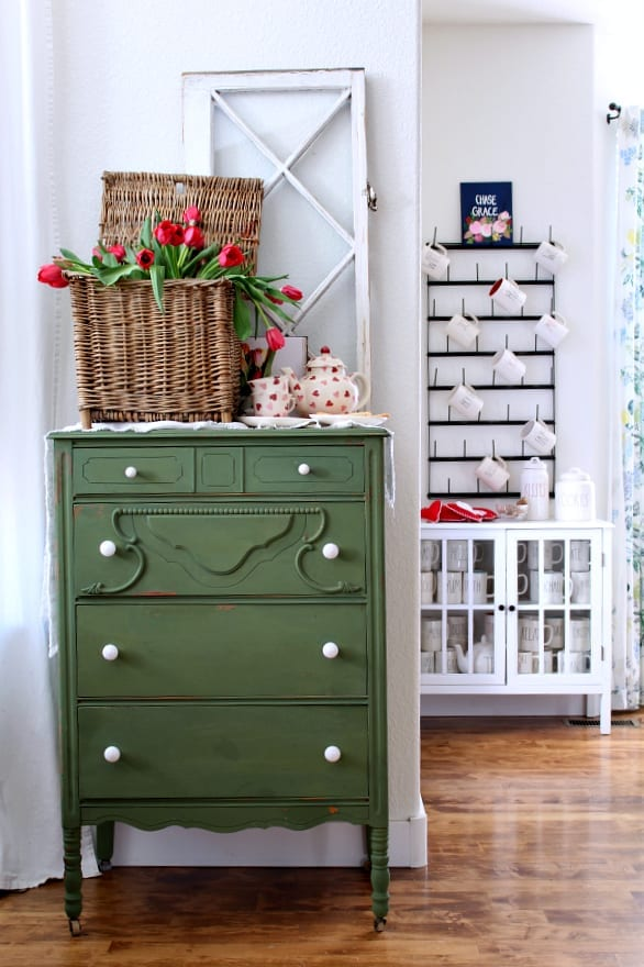 green dresser with heart decorated tea pot and yummy shortbread cookies!