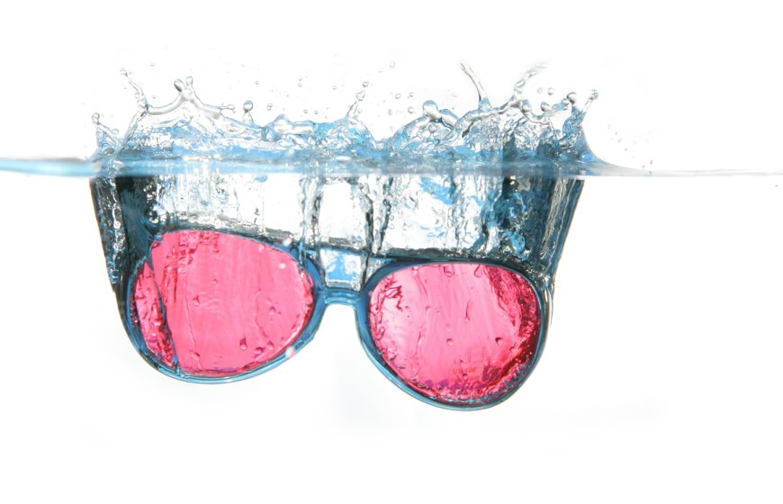 rose coloured glasses in water