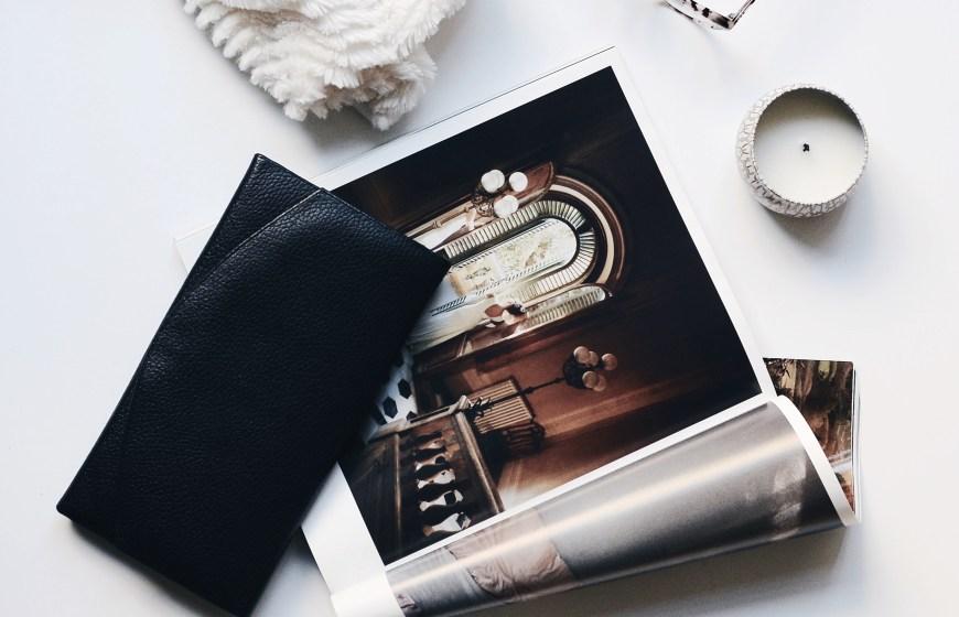 purse, magazine, blanket, candle and eyeglasses