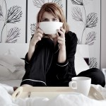 girl on bed drinking tea