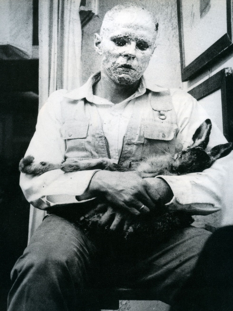 Artist Joseph Beuys during his performance with a dead hare at the Galerie Schmela in Düsseldorf. Wie man dem toten Hasen die Bilder erklärt [or How to Explain Pictures to a Dead Hare], 1965.