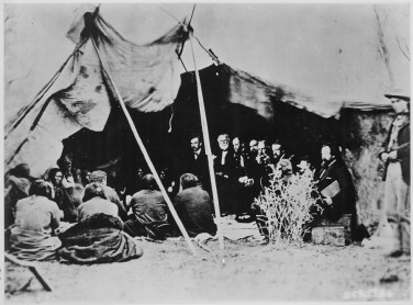 The Third Eye Magazine_Photograph_of_General_William_T._Sherman_and_Commissioners_in_Council_with_Indian_Chiefs_at_Fort_Laramie,_Wyoming,_ca._1_-_NARA_-