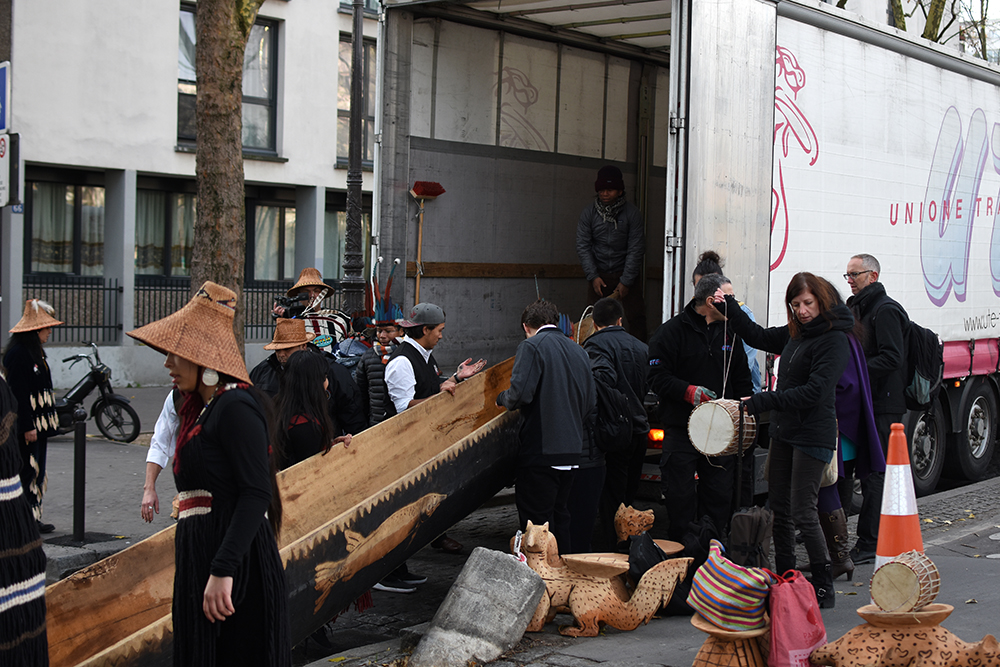 The Lummi Nation helping load the Canoe of Life into a truck, on its way to Le Bourget for exhibition at the Indigenous Pavilion during the COP21.