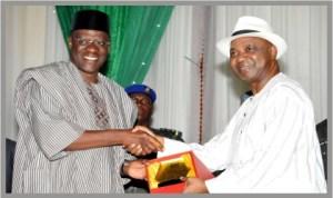 Vice President, Namadi Sambo (right), presenting an award to Governor Abdulfatai Ahmed of Kwara State during the 2013 World Teachers' Day celebration in Abuja last Saturday