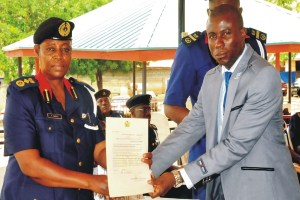 Deputy Commandant-General, Technical Services, Mrs Patience Agbiki (left),presenting private guards companies (pgc) licence to Director-General, Maritime and Land Security services, Prince Idodo Friday in Abuja last Wednesday. Photo: NAN.