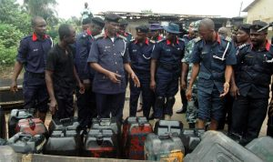 Commander General of NSCDC, Dr Ade Abolurin (3rd-left),  inspecting seized jerry cans of Petrol from vandals during his tour of Oke-Oko Isawo in Ikorodu, Lagos State recently.