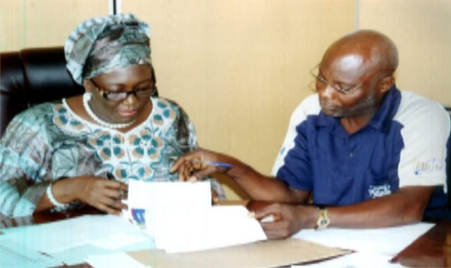 Perm. Sec, Ministry of Information and Communications Rivers State, Mrs. Cordelia Peterside (left) with Director, Admin. of the ministry; Hawkin's .T. Ide (right) in the bidding of the 2015 Calendar and Diaries at the ministry, recently. Photo:Egberi .A. Sampson