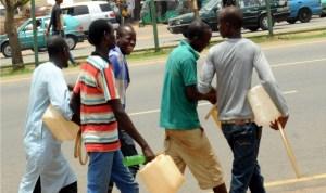 Ilegal petrol sellers at the NNPC Mega Station in Abuja last Saturday.
