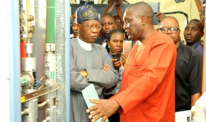 Minister for Information, Mr Lai Mohammed (left) with the General Manager, Integrated TV Service, Mr Rotimi  Salam, during the minister's inspection of NTA  digitisation  facilities in Jos recently.