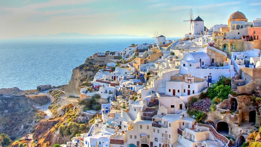 Greece special 2018  the best beach and island holidays   Travel     Windmills stand guard over the village of Oia  on Santorini