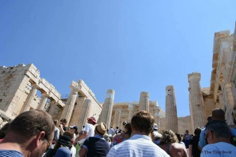 Athens Mythological Tour: Tourists crossing the Propylaea to reach the summit of the Acropolis.