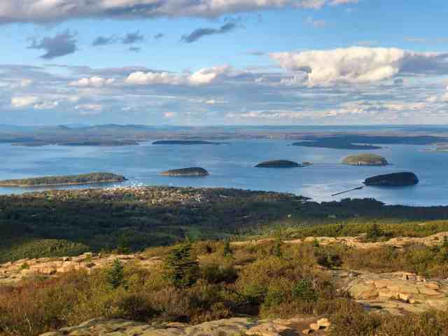 A view of Bar Harbor and the islands from the summit of Cadillac Mountain. best road trip new england