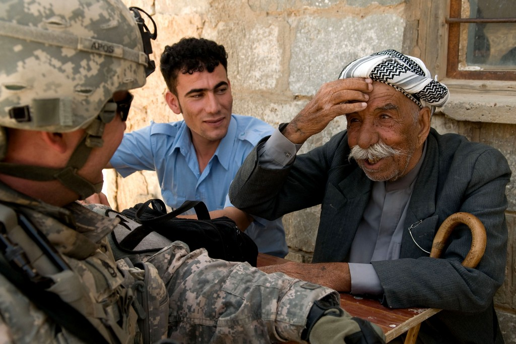 A Kurdish elder shows off his English to American troops in a village near Kirkuk, Iraq. Photo: US Department of Defense.