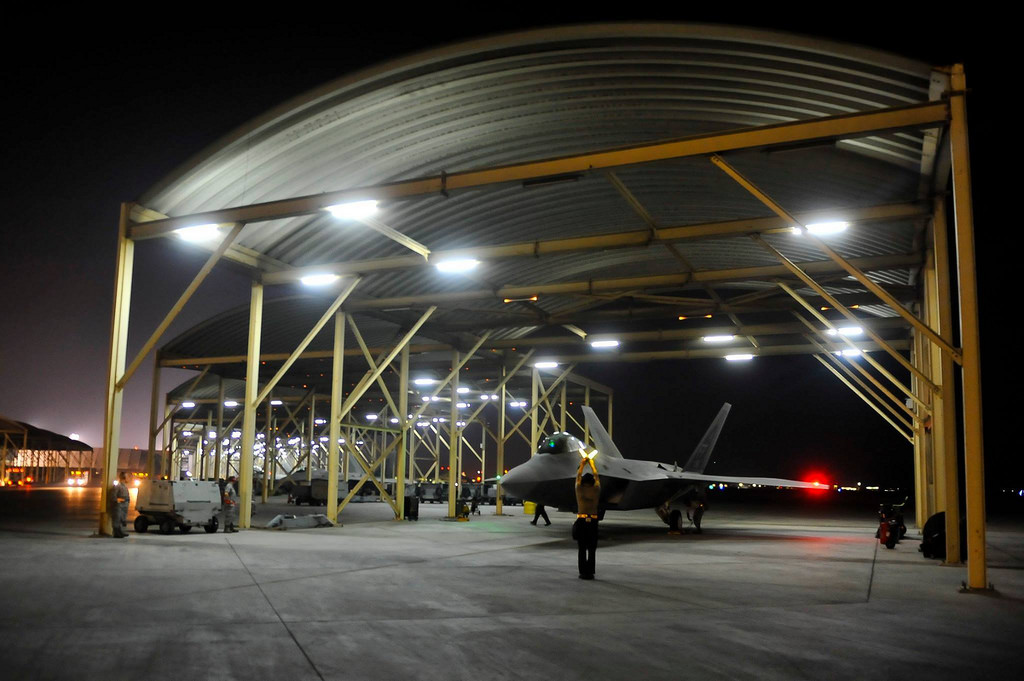 An F-22A Raptor waits to taxi prior to strike operations in Syria Sept. 23, 2014. These aircraft were part of a large coalition strike package that was the first to strike Islamic State targets in Syria. Photo: Russ Scalf / The National Guard / flickr
