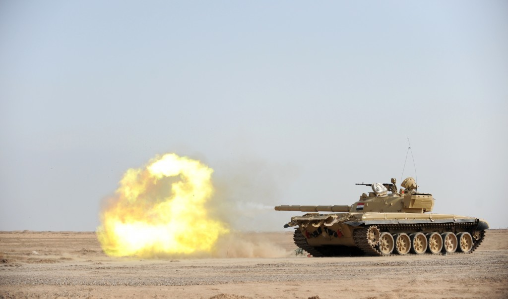 An Iraqi T-72 tank fires during a live fire training exercise at theBesmaya Gunnery Range near Baghdad. Photo: Jacob H. Smith / U.S. Army / Wikimedia