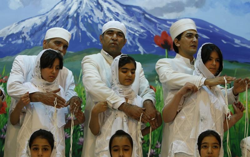 Zoroastrian priests performing a group Navjote initiation ceremony.