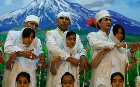 Zoroastrian priests performing a group Navjote initiation ceremony.