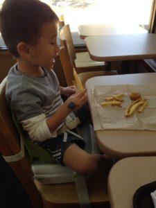 Tyler enjoying lunch while sitting on Yummigo