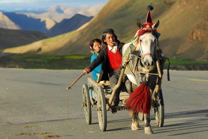 Tibetans travelling by coach, Tibetan Plateau