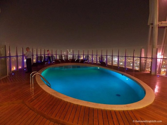 Infinity pool with city views at The Torch Doha