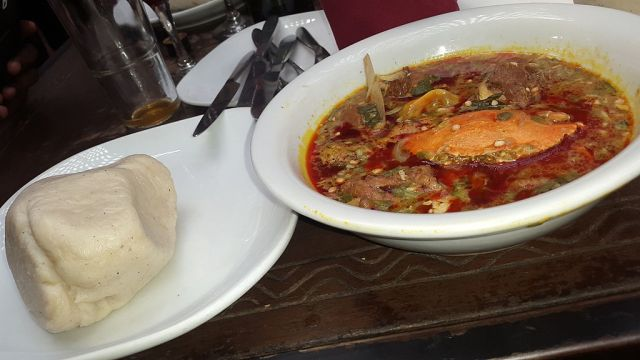 Ghanaian meal of banku and okra soup with crab meat