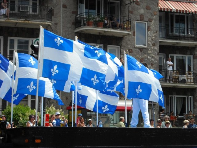 Quebec culture on display as flags of Quebec are flown with pride at a parade on Saint Jean Baptiste Day in Montreal, Quebec, Canada