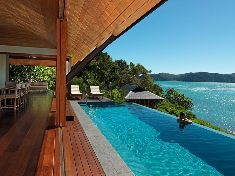 Luxury beach house dining room and lap pool at qualia, Hamilton Island
