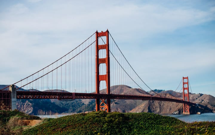 golden gate bridge in san francisco, california with hills in the background