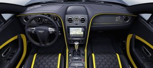 The dashboard's carbon fibre fascia panel displays an image of the seven planes in their signature Avenger flight formation, with the corresponding jet highlighted in Breitling Yellow.