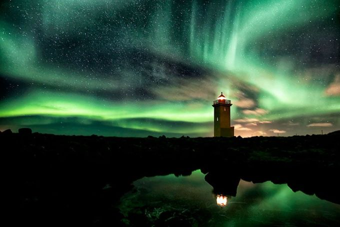 Lighthouse And Aurora-Filled Sky, Iceland
