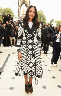 LONDON, ENGLAND - SEPTEMBER 21: Naomie Harris attend the Burberry Womenswear Spring/Summer 2016 show during London Fashion Week at Kensington Gardens on September 21, 2015 in London, England. (Photo by David M. Benett/Dave Benett/Getty Images for Burberry) *** Local Caption *** Naomie Harris