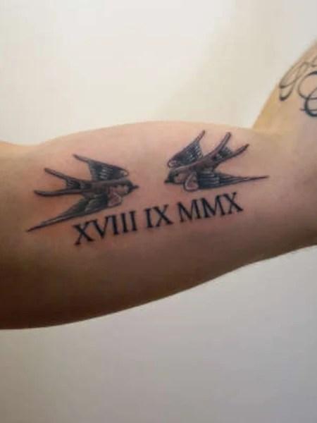 Roman Numerals And Bird Tattoo