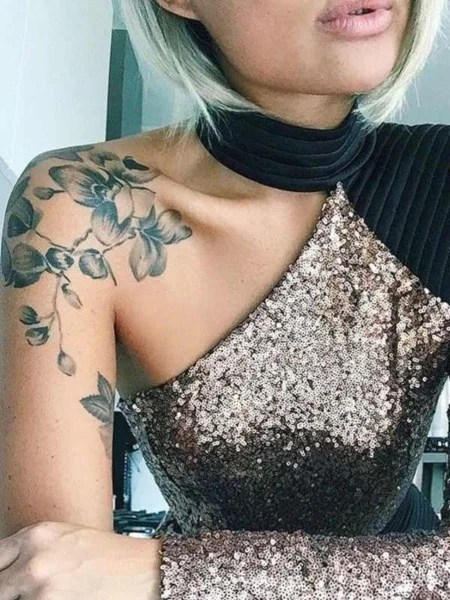 Shoulder And Arm Tattoo