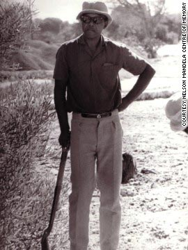 A photograph of Mandela working in a prison garden, taken in 1977, one of the 27 years he spent behind bars.